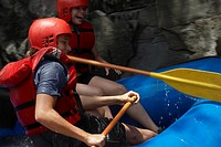 Side profile of a young couple rafting