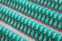 High angle view of empty green chairs in a stadium