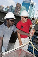 Close-up of two male construction workers working at a construction site