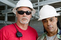 Close-up of two male construction workers at a construction site