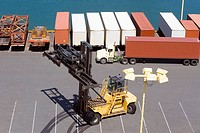 High angle view of cargo containers and a crane at a commercial dock