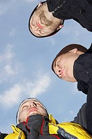 Low angle view of three young men