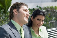 Close-up of a businessman smiling with a businesswoman