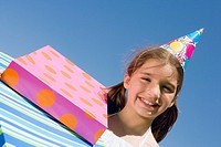 Portrait of a girl smiling with birthday presents