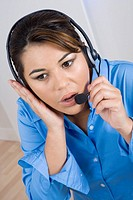 Close-up of a businesswoman wearing a headset and looking away