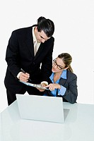 Businessman and a businesswoman working in an office