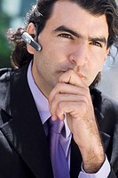 Close-up of a businessman wearing a hands free device