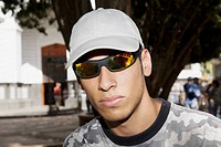 Close-up of a young man wearing sunglasses