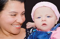Close-up of a young woman holding her son