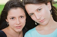 Portrait of a teenage girl with a young woman