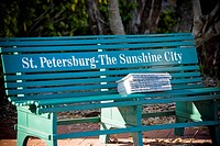 Stack of books on a park bench, St  Petersburg, Florida, USA