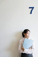 Woman standing with folders