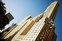 Low angle view of skyscrapers in a city, Irving Trust Company Building, Manhattan, New York City, New York State, USA
