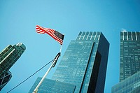 Low angle view of an American flag in front of buildings, World Trade Center, Manhattan, New York City, New York State, USA