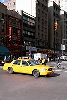 Yellow taxi on a road, New York City, New York State, USA