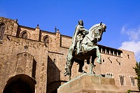 Low angle view of a statue on a pedestal in front of a building, Barcelona, Spain