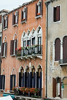 Window boxes hanging on the railings of windows, Venice, Italy