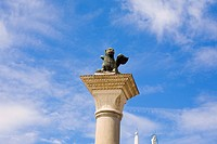 Statue of winged lion on a column, St  Mark's Square, Venice, Italy