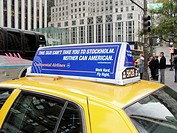 New York City. USA. 5th Avenue. Advertisement on a taxi for Continental Airlines uses Stockholm as a destination