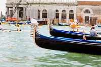 Gondolas in a canal in front of buildings, Regatta Storica, Venice, Italy