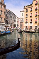 Gondolas in a canal, Venice, Italy