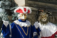 Close-up of two people in carnival costumes, Venice, Italy