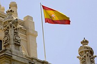 Low angle view of a Spanish flag fluttering on a building, Madrid, Spain
