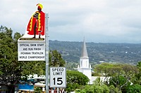 Speed limit signboard with a church in the background, Mokuaikaua Church, Kailua-Kona, Kona, Big Island, Hawaii Islands, USA