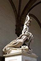 Low angle view of statues on a pedestal, Uffizi Museum, Florence, Tuscany, Italy