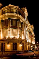 Low angle view of a building lit up at night, Nice, France