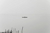 Silhouette of a person boating in a river, Cienaga, Atlantico, Colombia