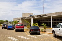 Cars parked in front of an airport entrance, Roatan, Bay Islands, Honduras