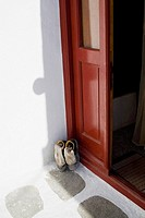 Pair of shoes at a door, Greece