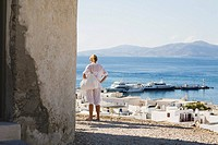 Rear view of a woman looking at a view, Mykonos, Cyclades Islands, Greece