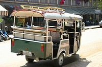 Rear view of a man driving a jinrikisha, Vientiane, Laos