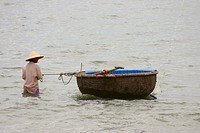 Fisherman in the sea with his tub boat, Hoi An, Vietnam