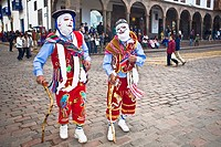 Two people wearing traditional costumes in a festival, Peru