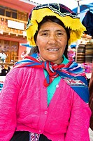Portrait of a mid adult woman sitting and smiling, Peru (thumbnail)