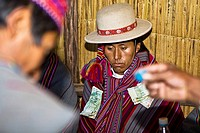 Close-up of a young man sitting at a wedding ceremony, Taquile Island, Lake Titicaca, Puno, Peru