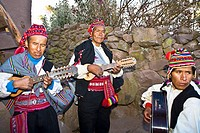 Three guitarists performing, Lake Titicaca, Taquile Island, Puno, Peru
