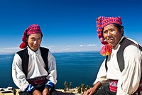 Portrait of two young men sitting, Taquile Island, Lake Titicaca, Puno, Peru