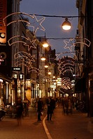The Hoogstraat in The Hague with christmas decorations and people shopping, the Netherlands, in the
