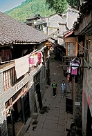 Elevated view of women walking on old street, Fenghuang, Xiangxi Prefecture, Hunan Province, People's Republic of China, FOR EDITORIAL USE ONLY
