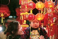Cheerful mother with son looking at lanterns, spring festival, Nanhou street, Fuzhou City, Fujian Province, People's Republic of China, FOR EDITORIAL ...