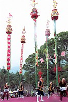 Performers balancing pole in festival, Winter jasmine folk art performance in country forest park, Fuzhou City, Fujian Province of People's Republic o...