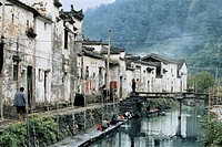 People washing clothes in river, Ming and Qing dynasty ancient buildings, Likeng Village, Wuyuan County, Jiangxi Province of People´s Republic of Chin...
