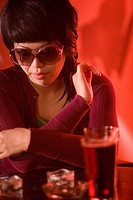 Close_up a young Asian woman in restaurant bar