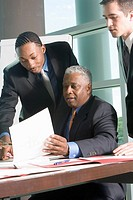 Business men reviewing paperwork
