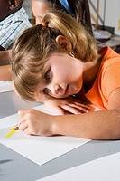 Close_up of girl drawing in class