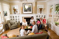 Family and friends together in living room